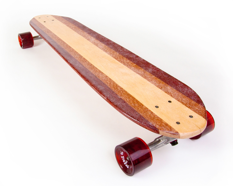 blunt longboard with maple-colored wheels